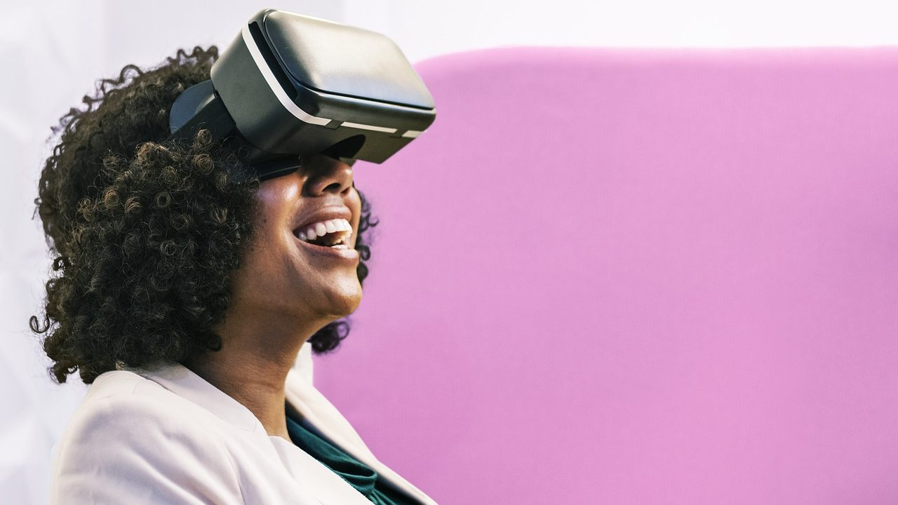 A female employee using virtual reality goggles for corporate training