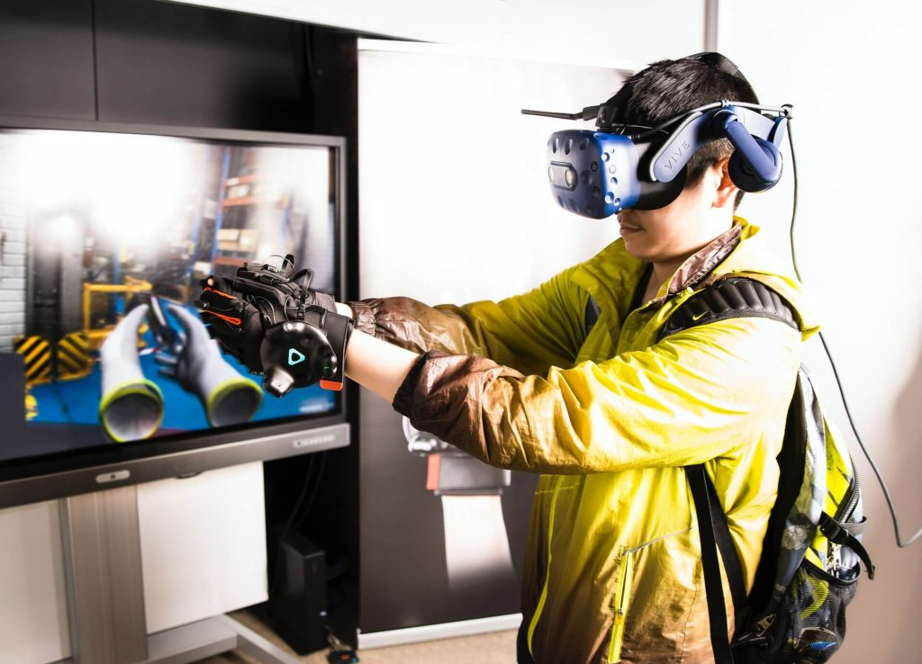 Person using immersive training technology to learn new skills in the workplace