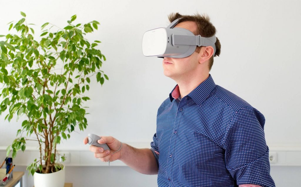 man using vr headset for virtual reality training