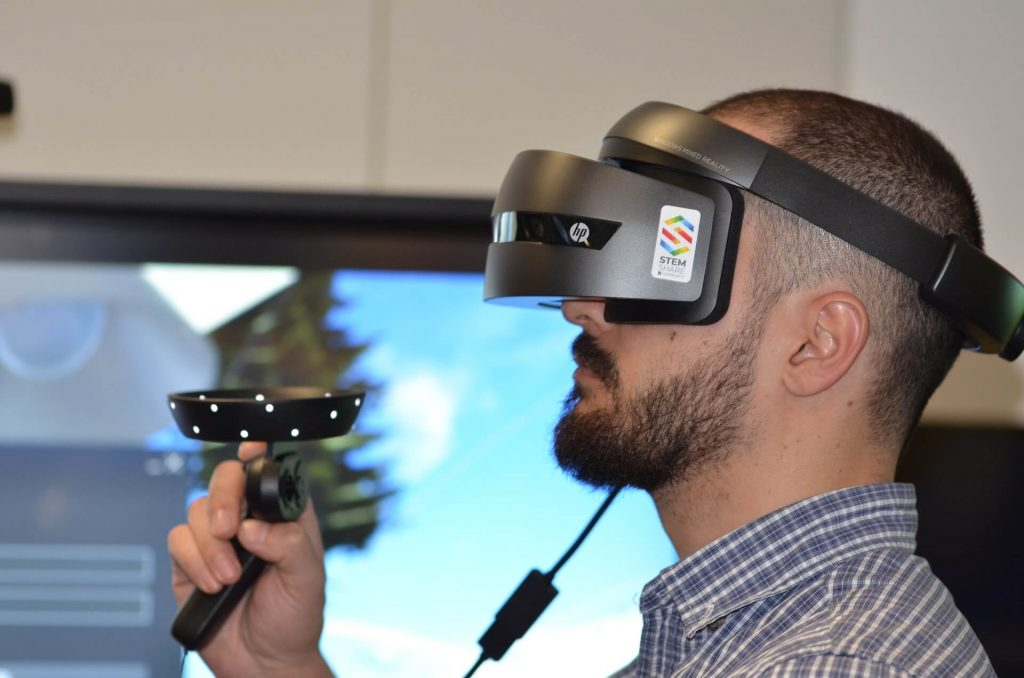 Man using virtual reality headset for distance learning
