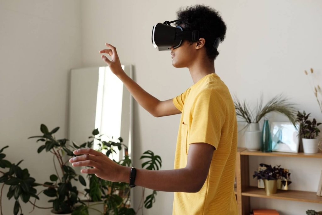 Boy using VR headset as part of modern education process